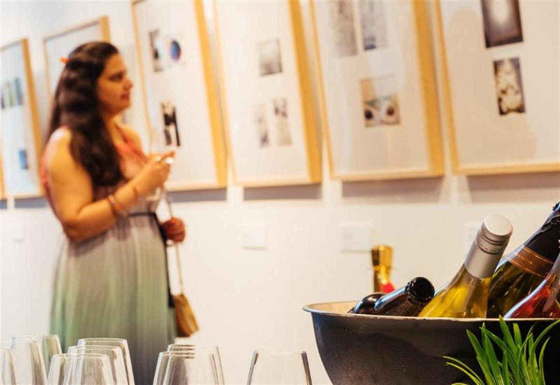 Lady admires artwork at Cube Gallery Event at Frankston Arts Centre