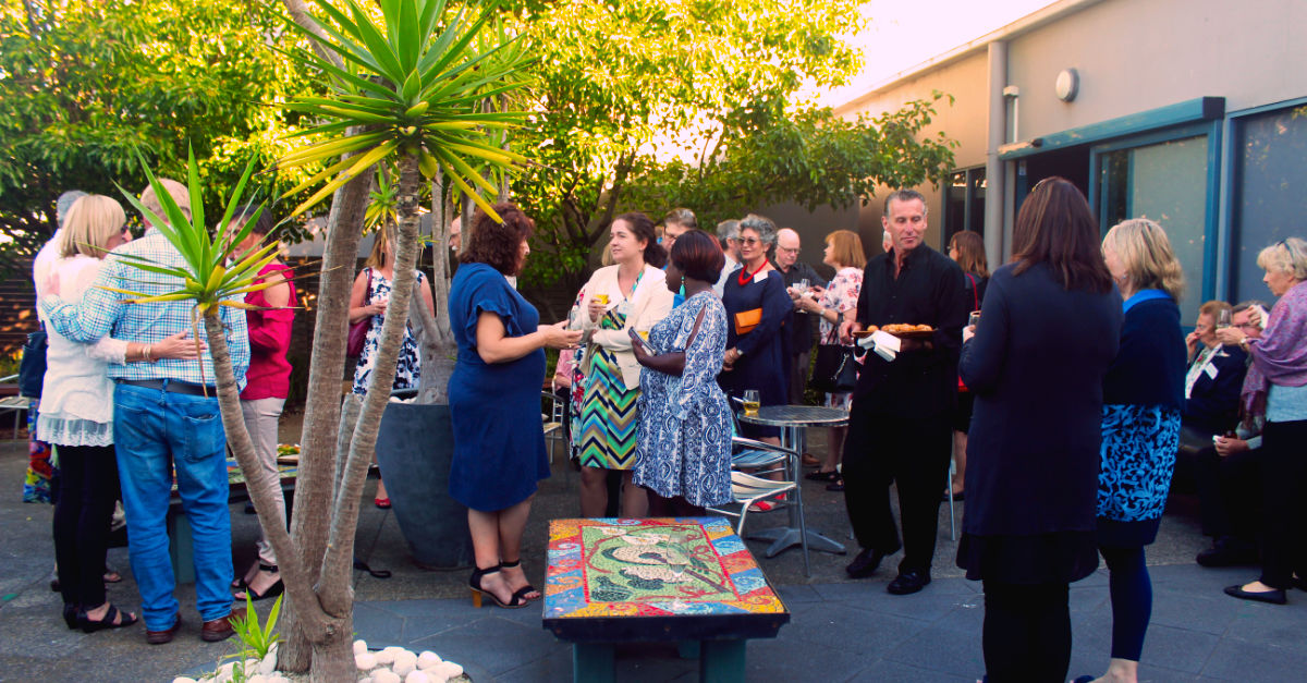 Guests enjoying refreshments in the courtyard at Cube 37 Frankston Arts Centre